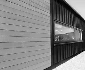 Cedar and iron cladding on exterior of relocatable home