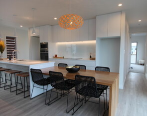 Contemporary white kitchen with feature American White Oak dining room